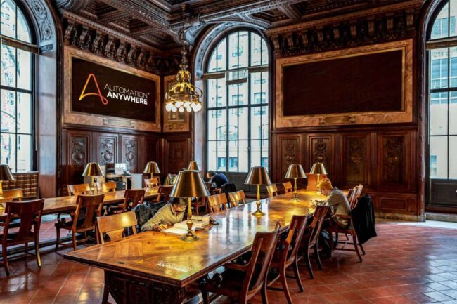 board room with automation anywhere logo