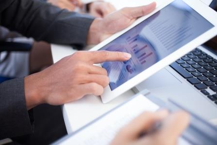 man typing on tablet pc screen
