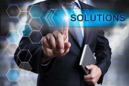 "Text reads ""solutions"" with man pointing his finger"